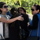Agonising wait: families of passengers who were on an EgyptAir jet that vanished en route from Paris to Egypt console each other at Cairo airport