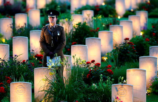 Poignant tribute: A soldier amongst illuminated graves during a vigil to commemorate the 100th anniversary of the beginning of the Battle of the Somme at the Thiepval Memorial