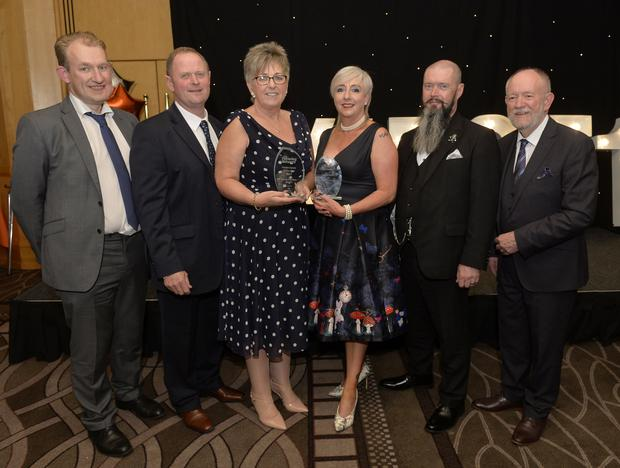 (L-R) Colm McCafferty, Southern Trust, William and Valerie Newell, Foster Carers of the Year, Orla and Pat Devlin Foster Carers of Distinction, Martin McGrath, Southern Trust.