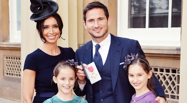 New family: Christine Lampard with Frank who received an OBE and his daughters Isla and Luna