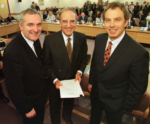 All smiles: (from left) then Taoiseach Bertie Ahern, former US Senator George Mitchell and then Prime Minister Tony Blair after the signing of the agreement at Stormont