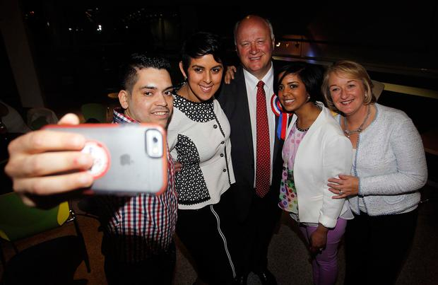 David Simpson of the DUP takes a selfie with his children, Steven, Leagh, Kristy and wife Elaine after being deemed elected in Upper Bann at the count in Banbridge, County Down
