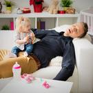 Wakey wakey: a dad dozes off while looking after his daughter
