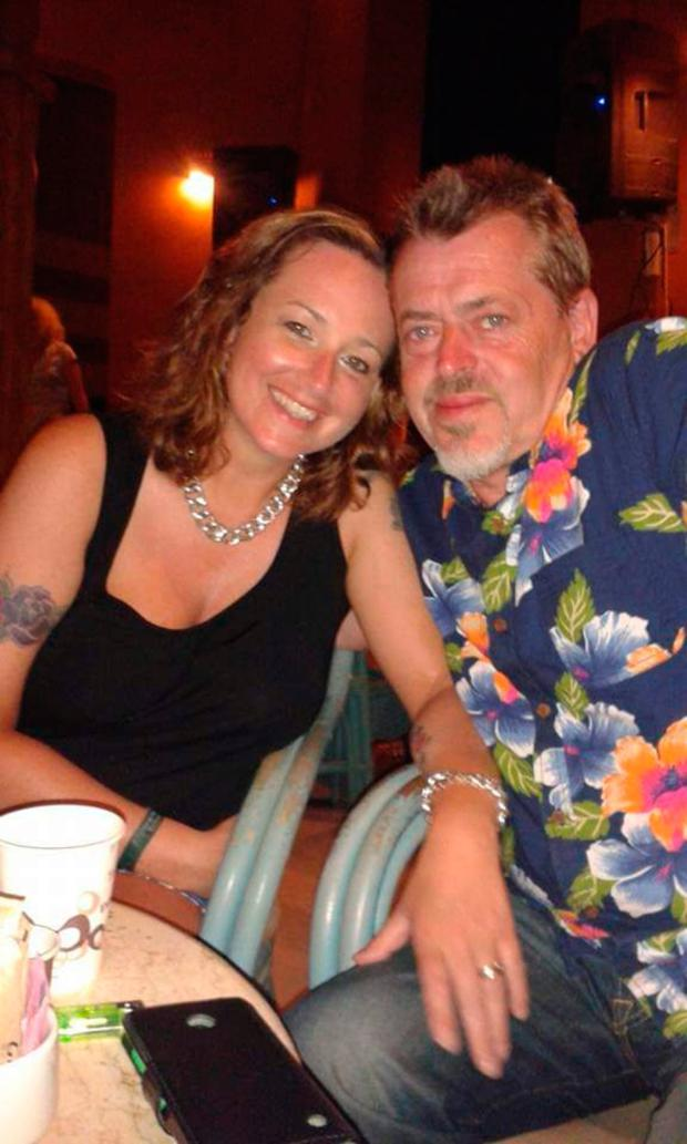 Happy couple: Carol with husband Neil on holiday in Egypt when she first started to notice symptoms of ovarian cancer