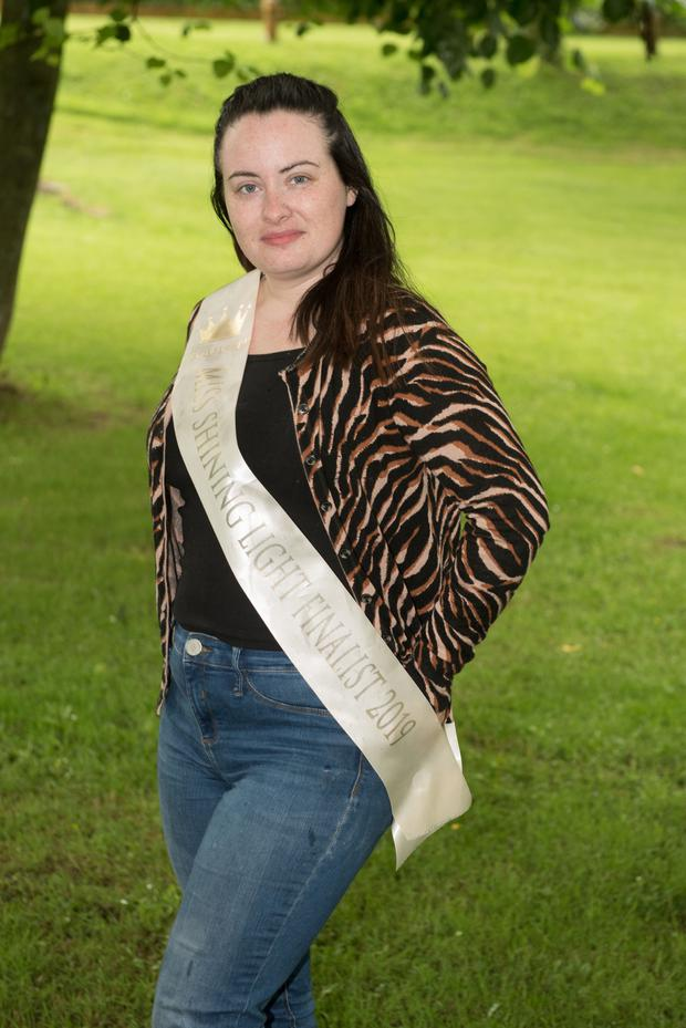 Patricia wearing her Shining Light sash