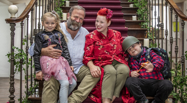 Grand design: Dick and Angel Strawbridge with kids Arthur and Dorothy on the staircase of their chateau