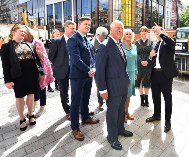 Prince Charles and Camilla visit Belfast after the fire
