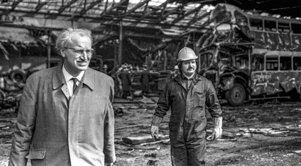 Troubled times: Werner Heubeck (left) at the scene of an IRA explosion at the Ulsterbus terminal at Winetavern Street in Belfast