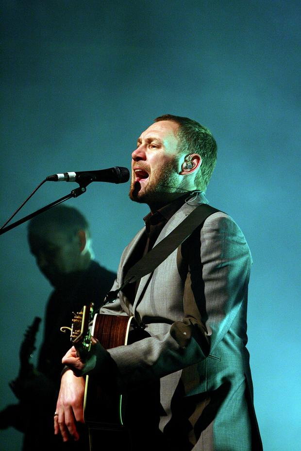David Gray performing his music on stage in 2009