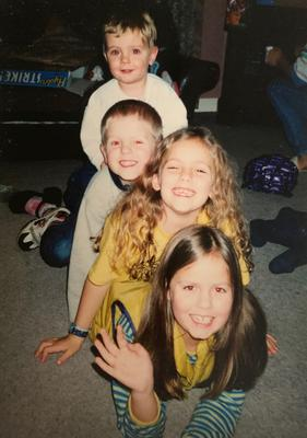 Happy family: Melissa with her sister Sharon and brothers Mark and Robert when they were kids