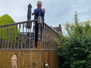 On the fence: Tom Kelly on his decking