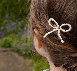 PearlsByTabs Pearl Bow Hair Comb, £9.10, available from Etsy