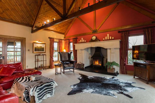 Hearth of the home: The drawing room has the feel of a hunting lodge
