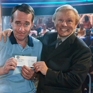 Matthew Macfadyen as Major Ingram and Michael Sheen as quizmaster Chris Tarrant