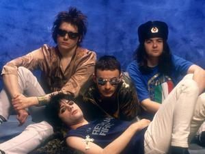 Manic times: Richey with bandmates (back row from left) Nicky Wire, James Dean Bradfield and Sean Moore in 1992, three years before Edwards disappeared