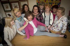 Among friends: Paula with members of the Galliagh Women's Group in Londonderry this week after receiving her new hair treatment