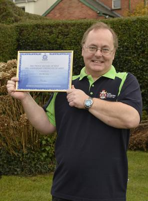 Jim with the certificate awarded to him at Buckingham Palace for services to life-saving
