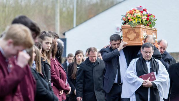Friends and relatives at John Irwin's funeral after the 16-year-old died from Sudden Adult Death Syndrome