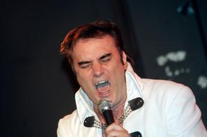 Rock on: Jim Brown burns up the calories as an Elvis impersonator