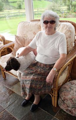 Enjoying life: Olive Wilson at home with her dog