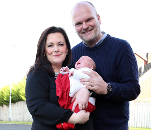 Proud parents: Radio Ulster presenters Kerry and Ralph McLean with four-week-old daughter Eve