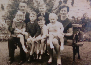 Happy memories: David on his mum Nancy's knee before he lost his leg. Also pictured (from left) is his late father Raymond with his sister Ann Marie on his knee, brothers John, Edmund and (standing at the back) Vincent
