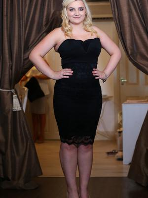 With the corset: Hairdresser Clare Brown demonstrates its effect on her waistline
