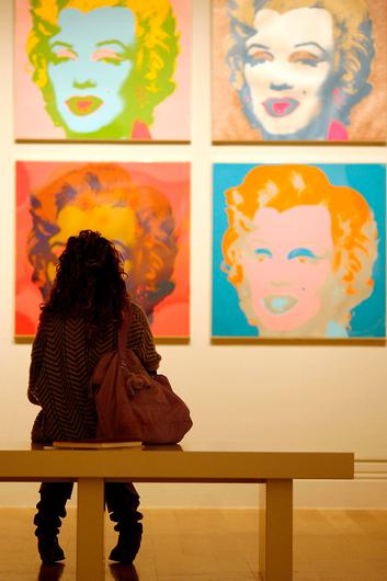 Popular: A visitor examines Andy Warhol's Marilyn Monroe painting at the National Portrait Gallery in London