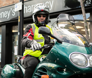 On your bike: Retired photographer Martin Boyd helped collect and deliver prescriptions, PPE and essential supplies