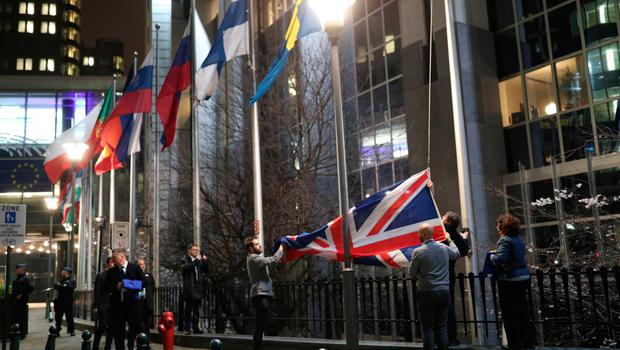The Union flag is taken down outside the European Parliament last night