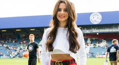 Cheryl with her abs out