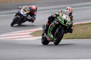 Jonathan Rea of Ireland and Kawasaki Racing Team WorldSBK (WorldSBK) leads Loris Baz of France and Ten Kate Racing Yamaha (WorldSBK) during the SuperBike race 1 during the WorldSBK French Round - Race 1 at Circuit de Nevers on October 03, 2020 in Magny-Cours, France.