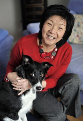 Smiling through: Anna Lo with her pet dog Jess