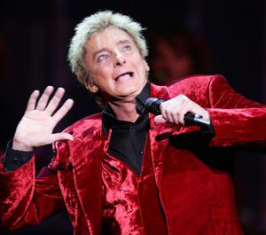 Legendary acts who Adrian has toured with including singer Barry Manilow