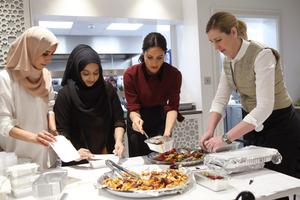 The Duchess of Sussex and Clare at the Hubb Community Kitchen in London, which helps refugees and homeless people