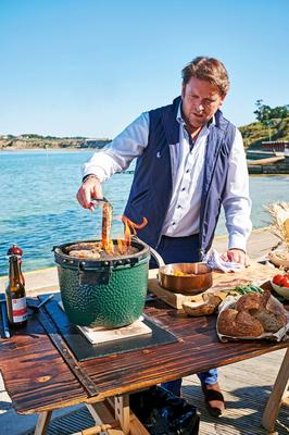Dining al fresco: James cooking on a barbecue on the Isle of Wight