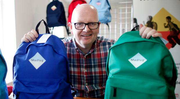 Carried away: Dave Linton founded Madlug to help provide bags, from rucksacks to travel bags, to children in care.