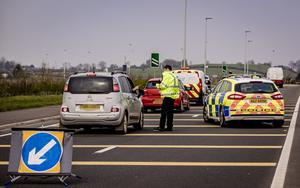 Checkpoint: Police talk to motorists during the lockdown in Northern Ireland