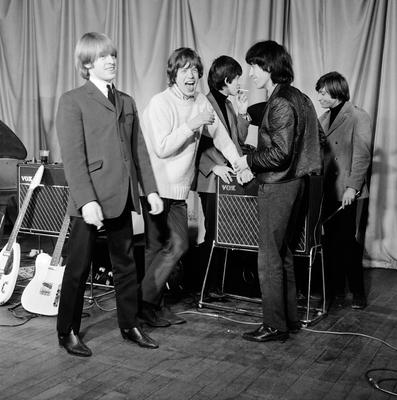 Rolling Stones: Brian Jones, Mick Jagger, Keith Richards, Bill Wyman and Charlie Watts backstage at The ABC Theatre in Belfast in January 1965