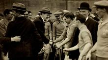 Michael Collins shakes hands with members of the Dublin team at the 1921 Leinster Hurling Final