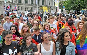 Strident voices: protestors, back right, object to the Pride parade. On the left are loyalist flag protestors
