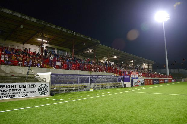 Fans watch a Larne game under the floodlights at Inver Park