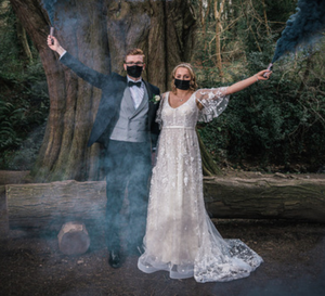 Cover up: newlyweds Matthew Fitch and Bronte wearing masks on their wedding day