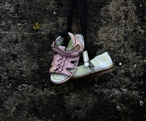 Disgrace: A pair of infant shoes at the shrine on a mass burial site, formerly part of the Bon Secours Mother and Baby home. (Photo by Charles McQuillan/Getty Images)