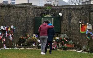 Legacy: families at the shrine on a mass burial site in Tuam