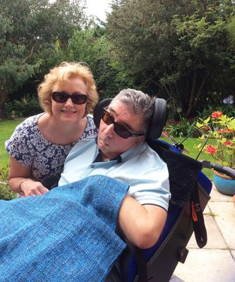 Gary back home in his garden after he suffered a brain haemorrhage
