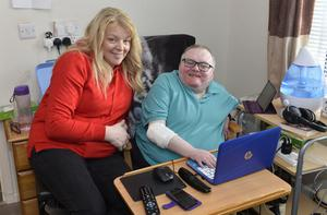 So close: Lee Martin, who suffers from diploid triploid mosaicism, at his Enniskillen home with mum Caroline Wheeler