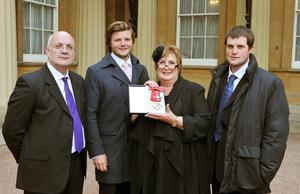 Dame Jenni Murray with (from left) husband David and sons Charlie and Ed in 2011 after she was made a Dame Commander by the Queen