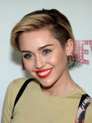 Miley Cyrus as she is today following dental treatment