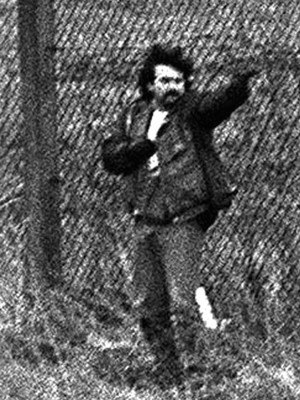 Pistol-toting lone wolf loyalist Michael Stone launches his murderous attack on Milltown Cemetery